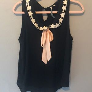 Black blouse with pink and white detail